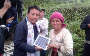 Phurpa Lama with local woman, sharing solar light and hope!